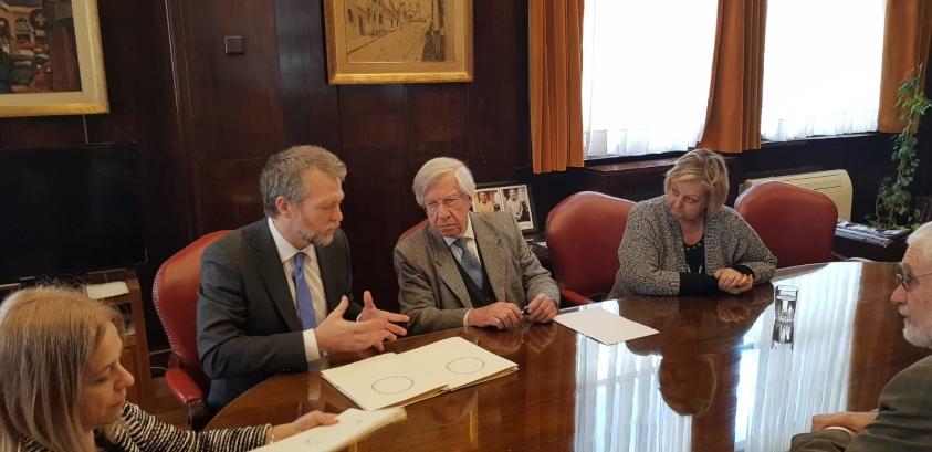 Doyle, Astori, Kechichian y Liberoff durante la firma del acuerdo.